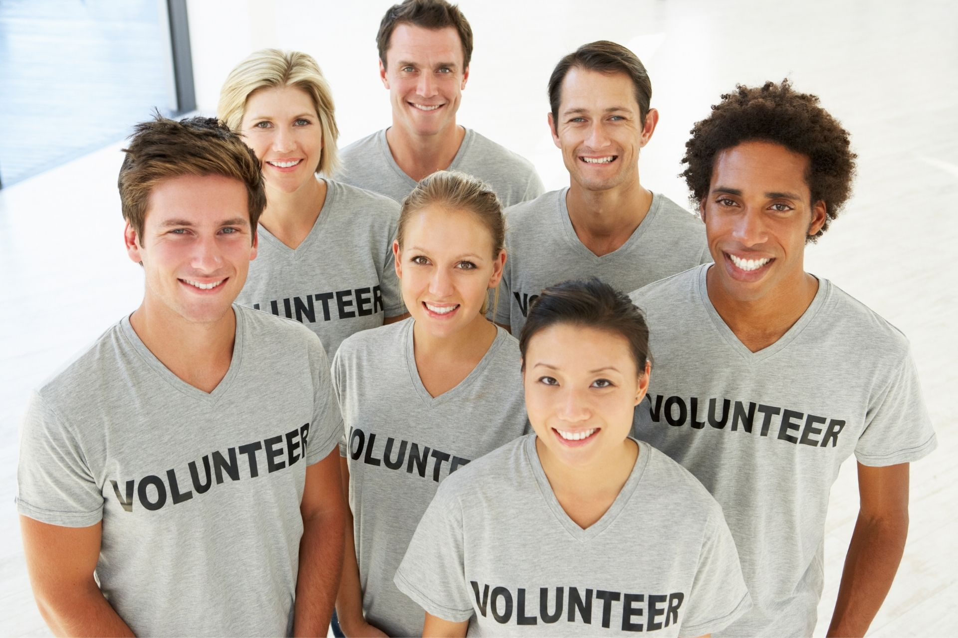 Canva Graphic showing group of Volunteers