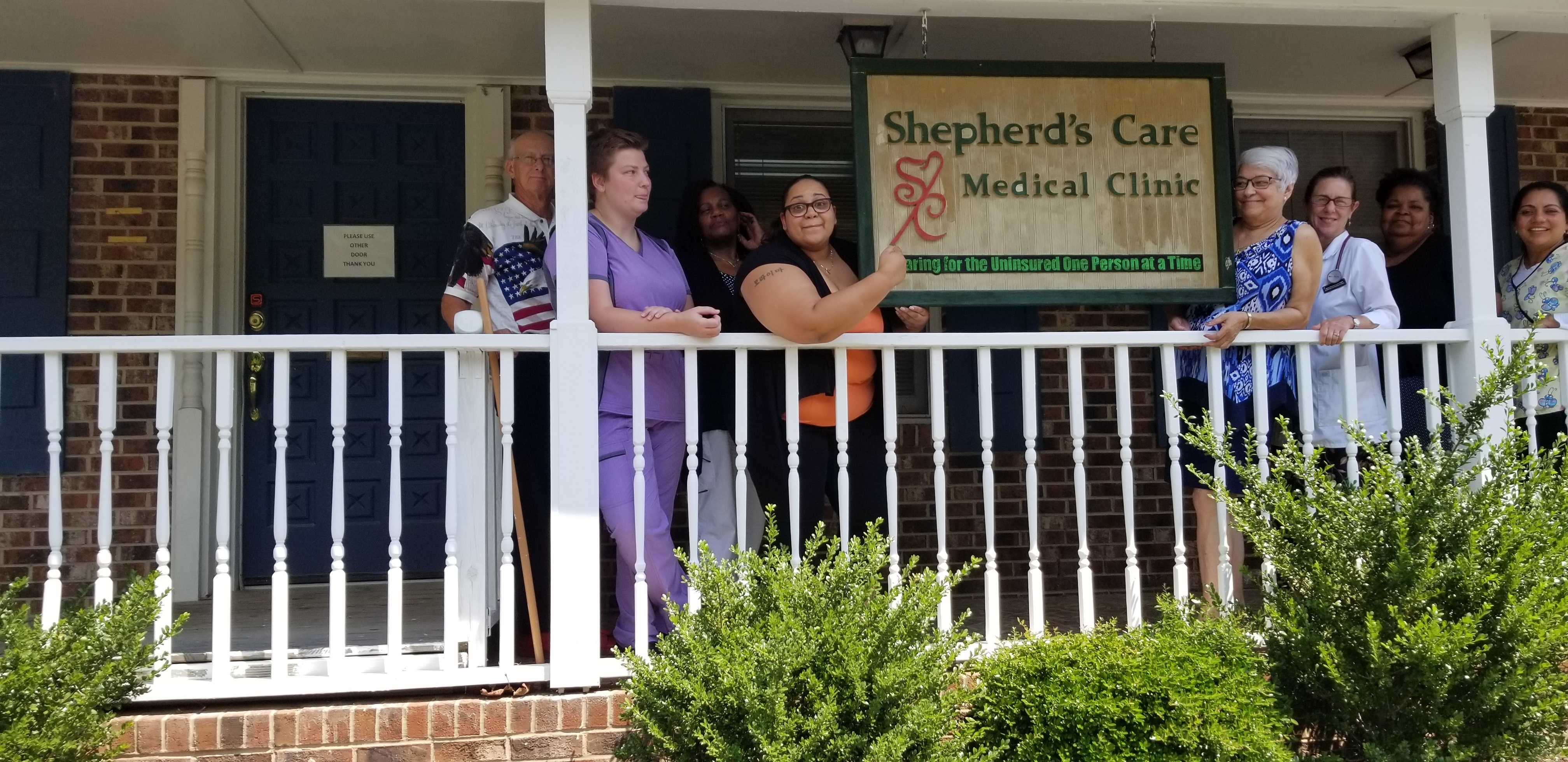 Employees standing in front of Shepherd's Care Medical Clinic