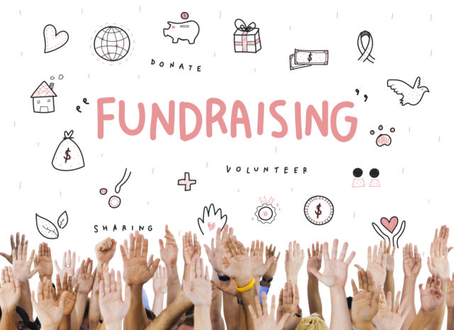 Handings reaching up towards the word 'fundraising'